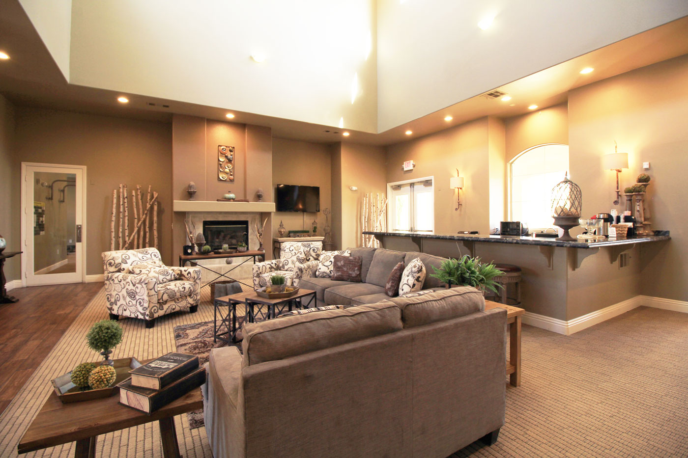 View of lounge with grey and white couches and rustic decor.