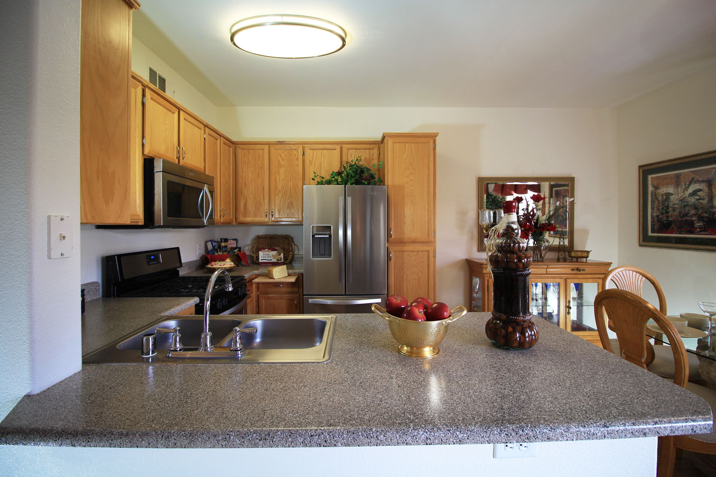 Overview of Kitchen at La Villa Estates with stainless steel appliances.