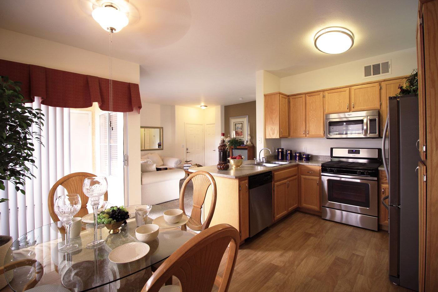 View of kitchen and dining room at La Villa Estates.