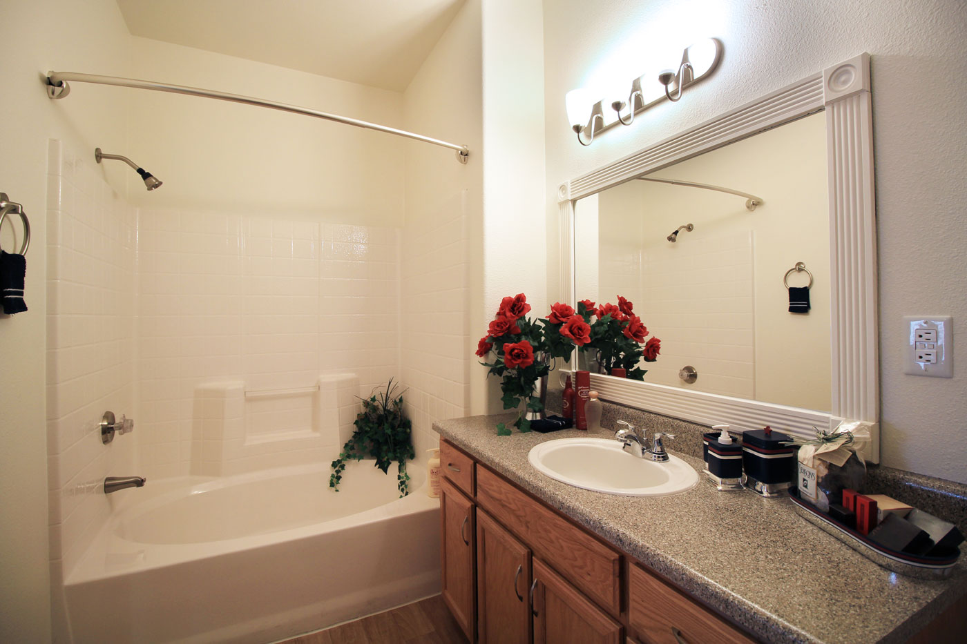 Full bathroom with floral decor.